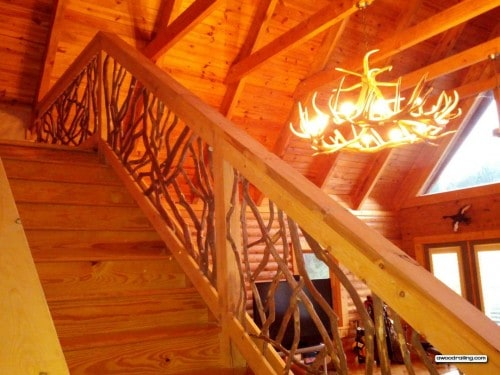 stair handrail and antler chandelier