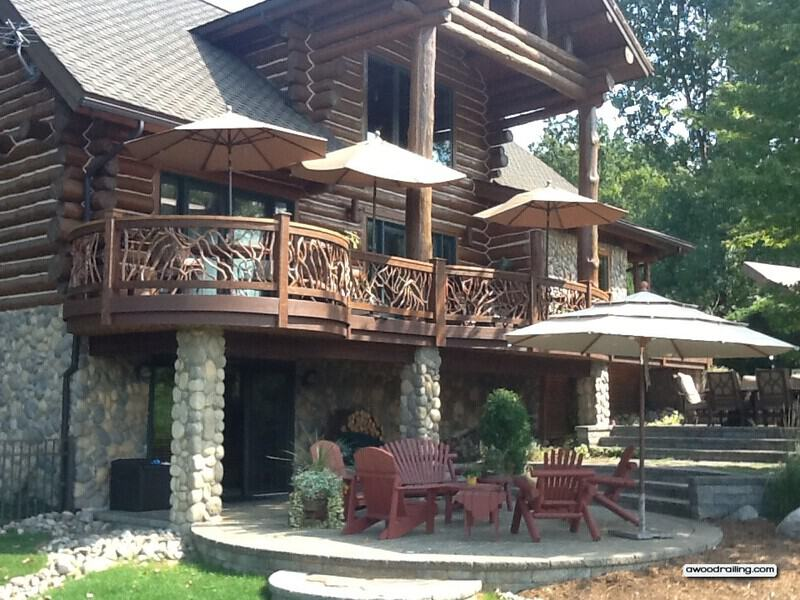Gorgeous curved deck railing installed on log home for Log home decks