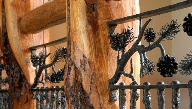 log-post-top-rail-w-metal-vert-branches-pine-cones