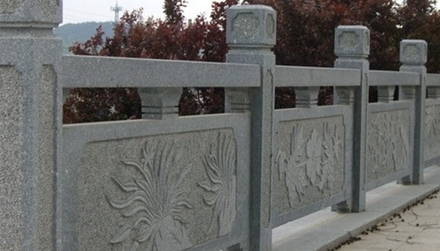 stone-solid-guardrail-w-carvings