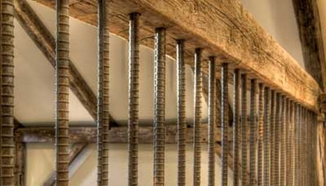 Vertical rebar baluster with wood beam rails deck railing mountain