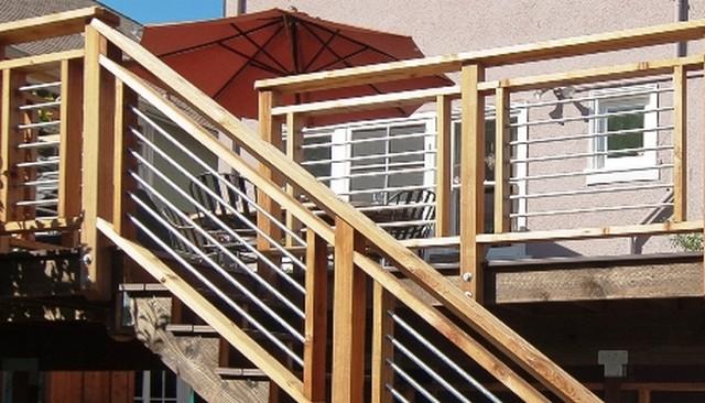 Wood framed horizontal metal pipe railing deck railing for Balcony handrail design