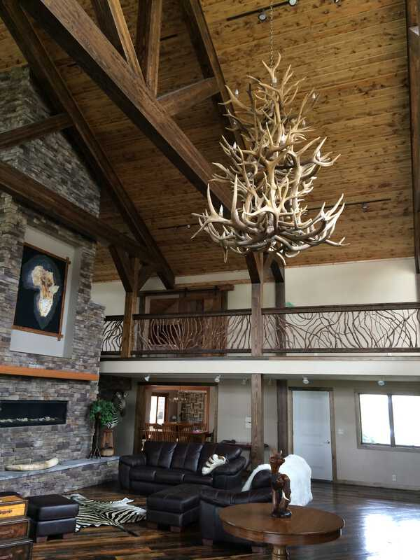 Balcony Railing with Antler Chandelier