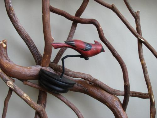 Carved Cardinal Mounted to Railing