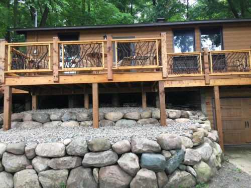 Stone Landscaping And Wood Siding